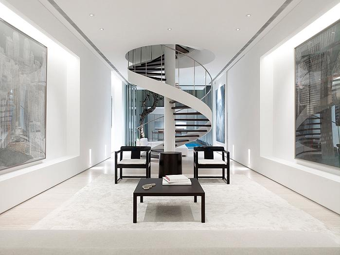 beautiful wide spiral staircase An Elegant Solution To A Long And Narrow Space