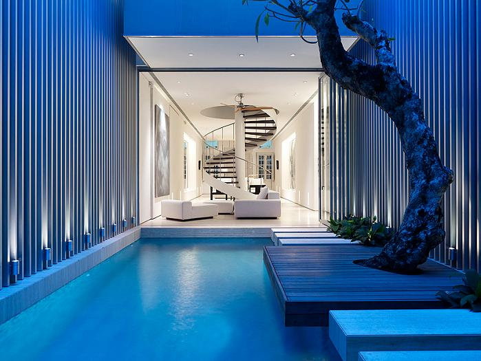 private outdoor pool inside with tree An Elegant Solution To A Long And Narrow Space