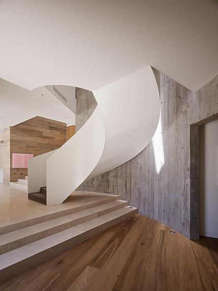 a spiral staircase The Yarra House: Interior Design Inspiration