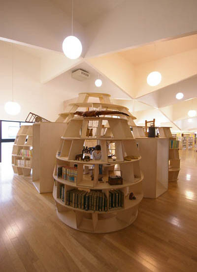 enclosed bookshelf area space with seating and tables built in Yamakoya: The Japanese Bookshelf Cabin