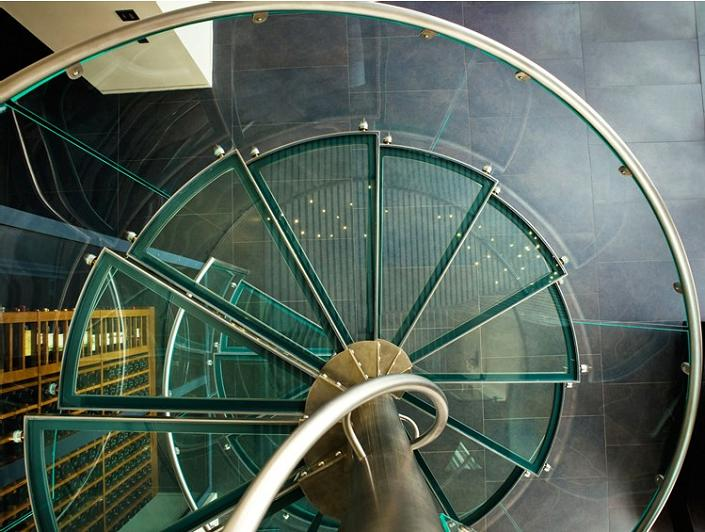 glass spiral staircase from above The $10 Million Aquarius Penthouse Feels Like a Nightclub