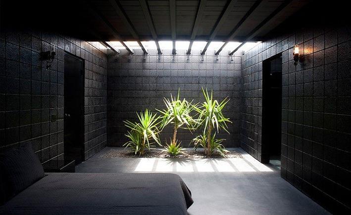all black interior design bedroom rosa muerta What Happens When a Punk Rocker Designs a Desert Home?