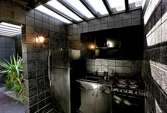 all black kitchen interior design inspiration What Happens When a Punk Rocker Designs a Desert Home?