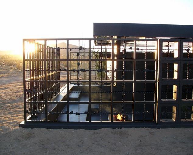 open concept desert hotel room all black What Happens When a Punk Rocker Designs a Desert Home?