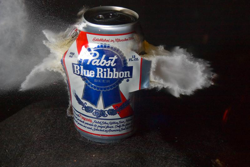 hollow point bullet through pabst blue ribon beer can Picture of the Day   January 23, 2010