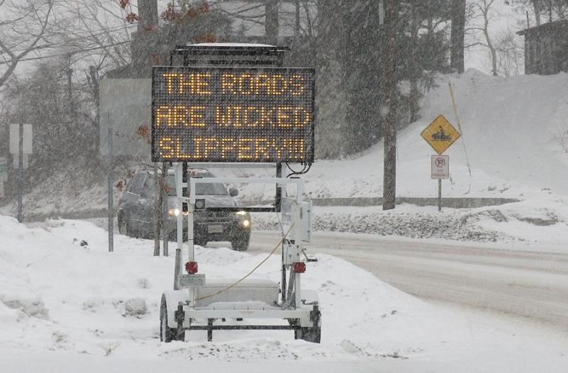 the roads are wicked slippery traffic sign hack Picture of the Day   January 3, 2010
