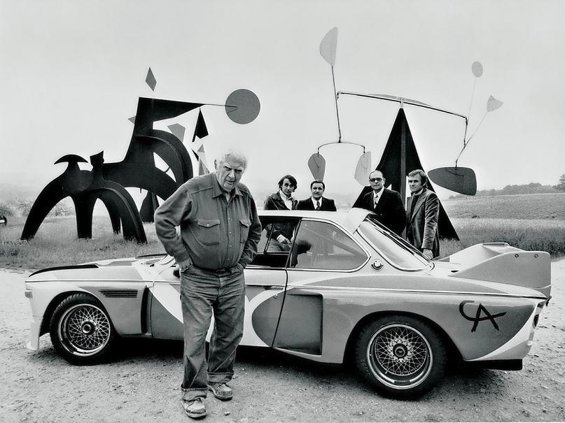 first bmw art car alexander calder posing with bmw The Evolution of the BMW Art Car