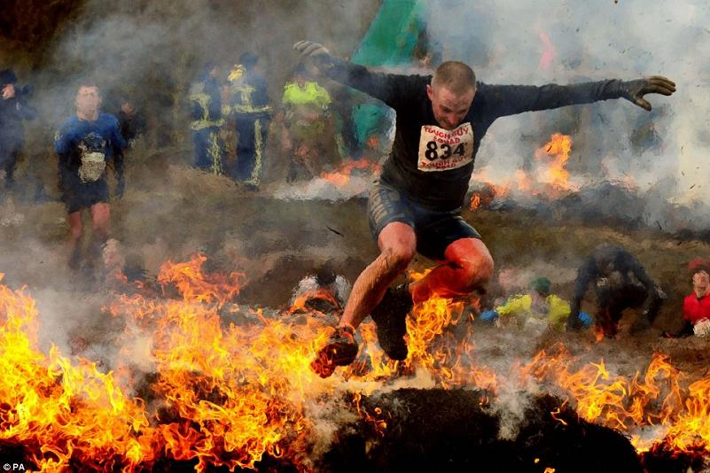 man jumping through fire tough guy contest Picture of the Day   February 2, 2010