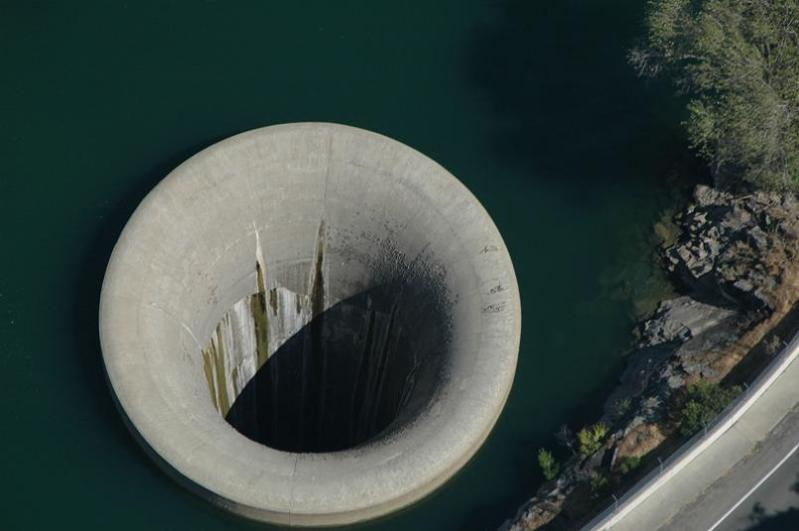 massive hole in the water Bell Mouth Spillways: How Giant Holes in the Water are Possible