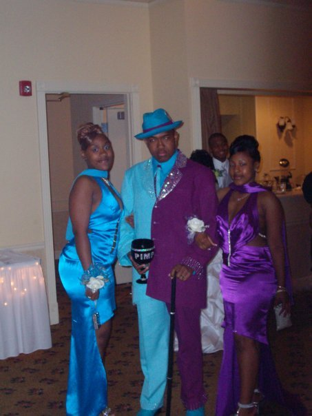 pimp with half blue half purple suit and two women and chalice The Friday Shirk Report   May 21, 2010   Volume 58