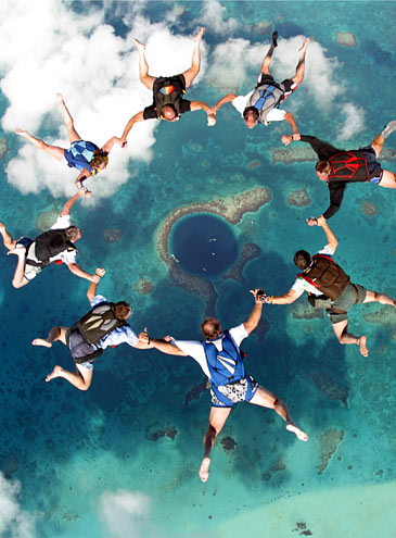 sky diving over the giant blue hole belize aerial The Great Blue Hole in Belize