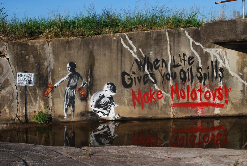 when live gives you oil spills make molotovs graffiti street art Picture of the Day   May 16, 2010
