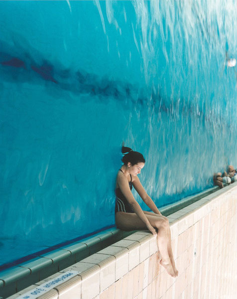 woman sinking into wall of water 90 degrees Picture of the Day   Tilt Head Right