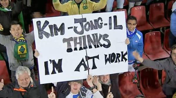 kim jong il thinks im at work funny sign at world cup 2010 The Friday Shirk Report   June 18, 2010 | Volume 62