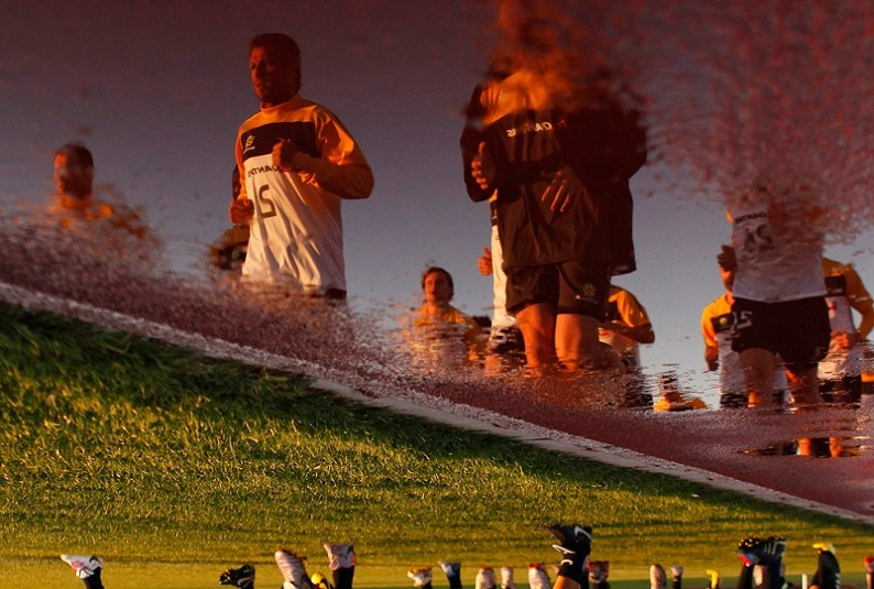 lucas neil reflected in water australia soccer football team Picture of the Day   June 10, 2010