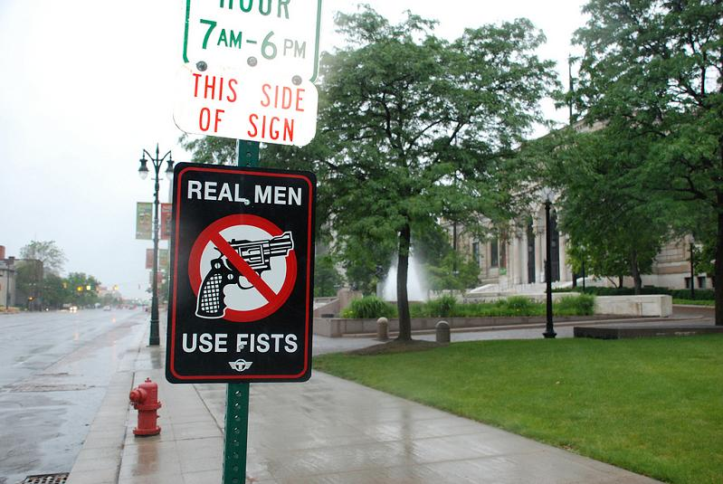 real men use fists anti gun street sign trustocorp Signs of the Times by Trusto Corp