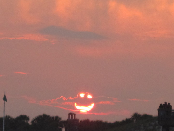 happy face sun is smiling through clouds Picture of the Day   July 1, 2010