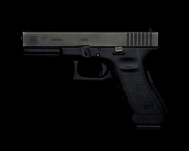 glock 17 handgun on black background Guns and Roses by Guido Mocafico
