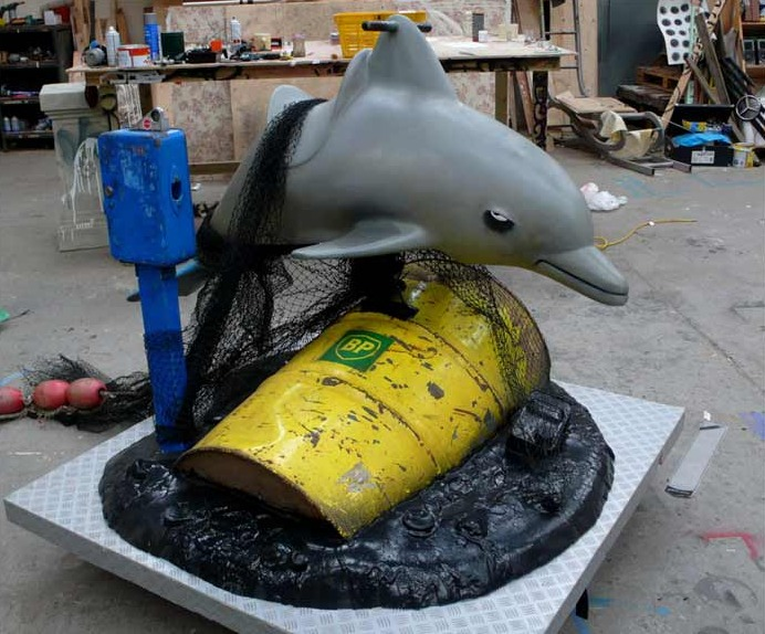 banksy dolphin ride bp oil spill drum barrel Picture of the Day   This Oil Ride is Slick