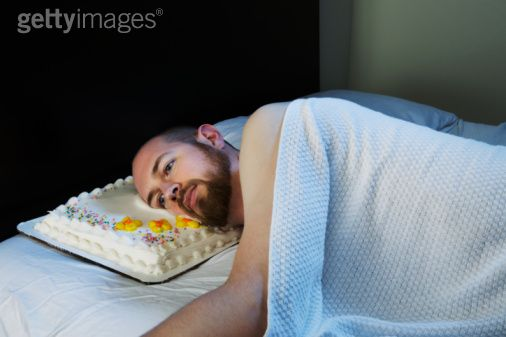 man laying in bed with cake pillow The Friday Shirk Report   October 1, 2010 | Volume 77