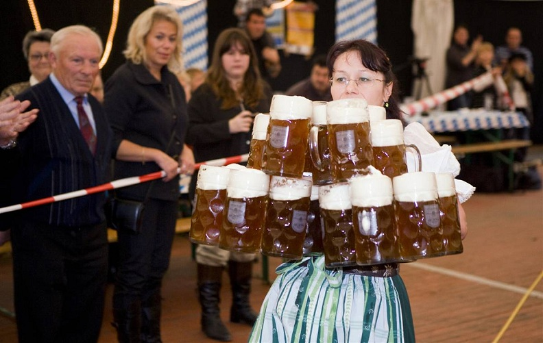 woman carrying lots of beer oktoberfest Picture of the Day   October 12, 2010