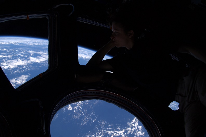 woman-astronaut-looking-at-earth-from-space