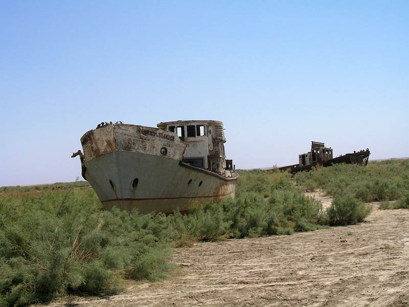 orphaned ships in the former aral sea harbor of moe28098ynoq uzbekistan 25 Haunting Shipwrecks Around the World