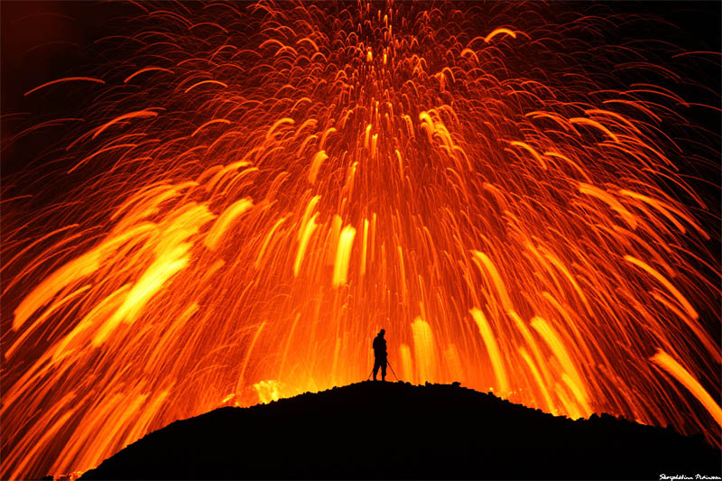 standing in front of erupting volcano Picture of the Day: Playing with Fire