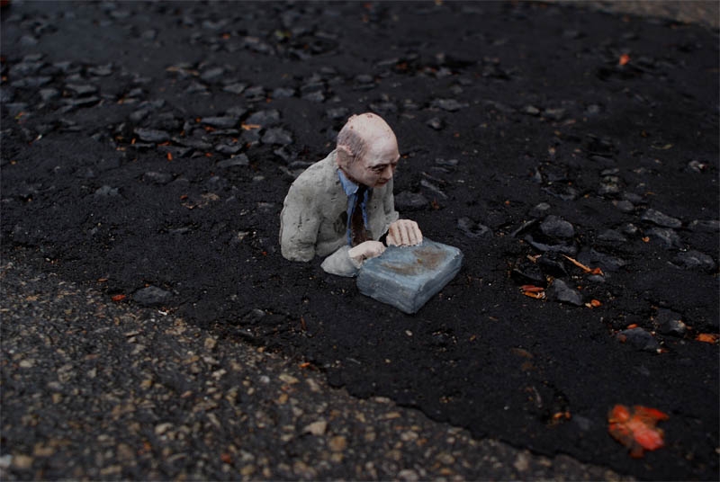 cement miniature sculptures artist isaac cordal 16 Cleverly Placed Miniature Cement Sculptures by Isaac Cordal