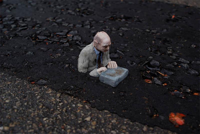 cement miniature sculptures artist isaac cordal 16 Cleverly Placed Miniature Cement Sculptures by Isaac Cordal
