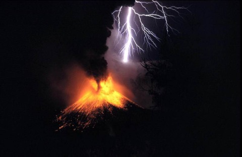 Lightning and eruption at Mount Rinjani volcano in Indonesia
