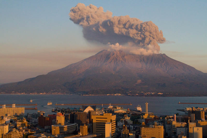 sakurajima volcano at sunset japan 30 Incredible Photos of Volcanic Eruptions