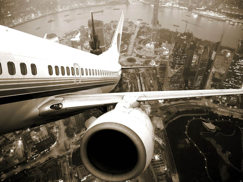 view of city behind plane taking off shanghai Picture of the Day: I want to fly away