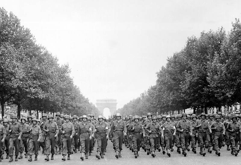 wwii liberation of paris american troops march down the champs elysees This Day In History   October 19th