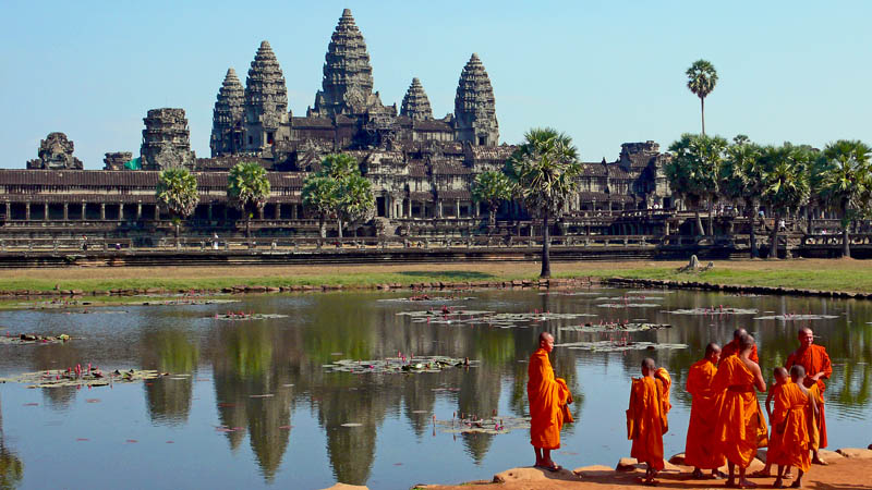 buddhist monks in front of the angkor wat This Day In History   November 9th