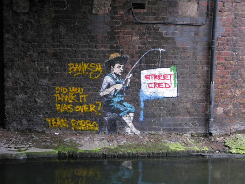 banksy fishing for streed cred robbo war Street Artist and City Worker Have Year Long Exchange on a Red Wall in London