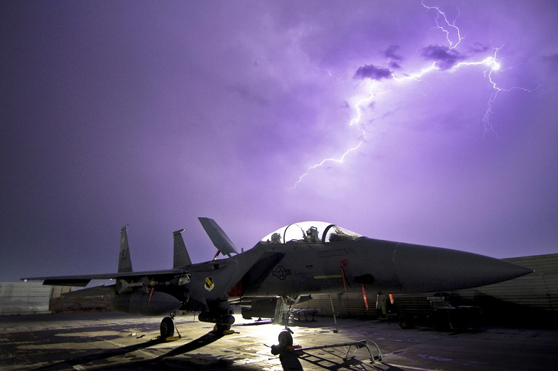 f 15e strike eagle fighter aircraft is illuminated by a lightning storm The Fastest Plane on Earth [25 pics]