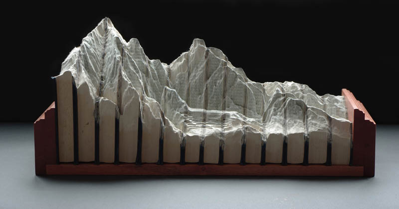 landscapes carved into books guy laramee 10 Incredible Landscapes Carved Into Books