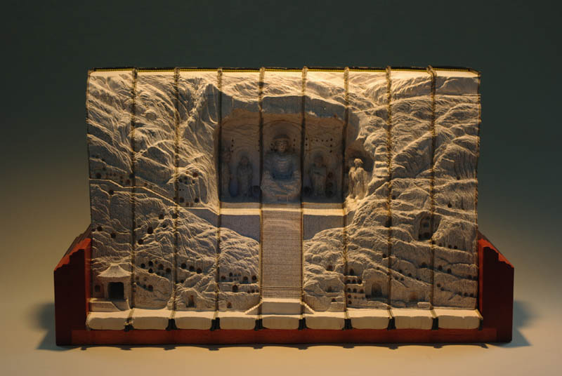 landscapes carved into books guy laramee 13 Intricate Book Art Carvings by Brian Dettmer