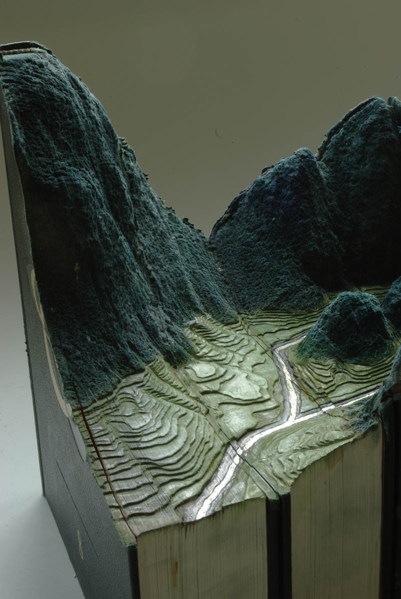 landscapes carved into books guy laramee 8 Incredible Landscapes Carved Into Books
