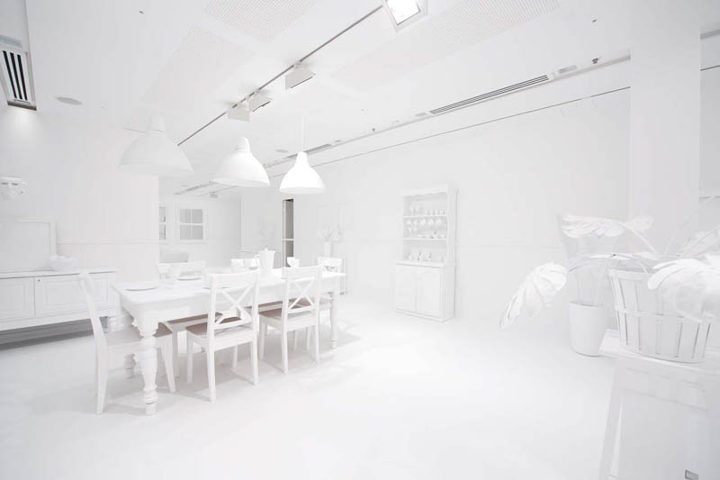 white room covered in stickers by kids yayoi kusama obliteration room 3 Kids Turn White Room into Explosion of Color