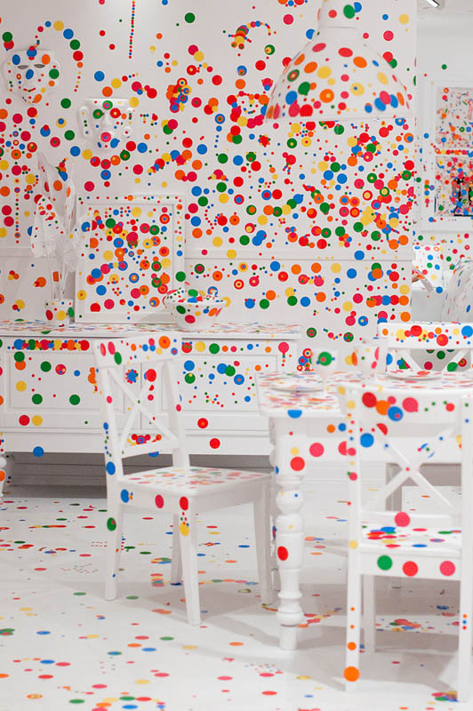 white room covered in stickers by kids yayoi kusama obliteration room 8 Kids Turn White Room into Explosion of Color