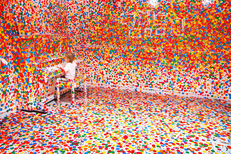 white room covered in stickers by kids yayoi kusama obliteration room 9 The Before I Die Project