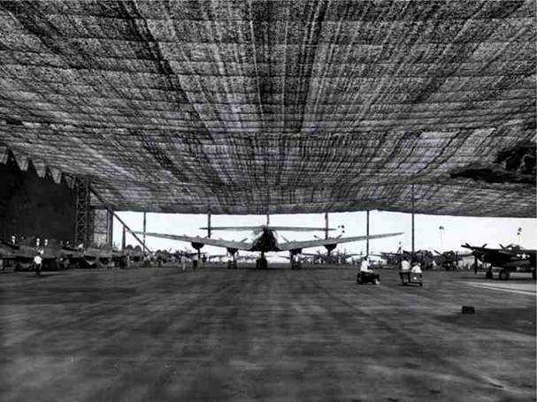wwii lockheed covered in netting 4 Hiding Air Bases, Factories and Plants in WWII