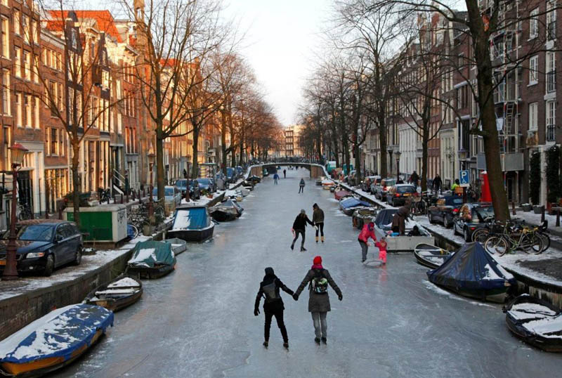 ice skating amsterdam frozen canals netherlands holland 7 The 65 Foot (20m) Snow Corridor in Japan