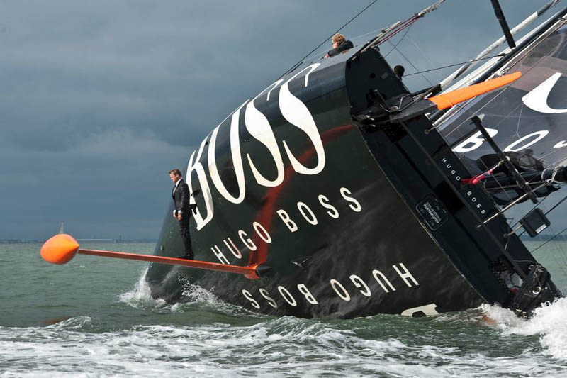 keel walk hugo boss suit boat sailing standing on rutter Standing on the Bulbous Bow of the Worlds Largest Ocean Liner