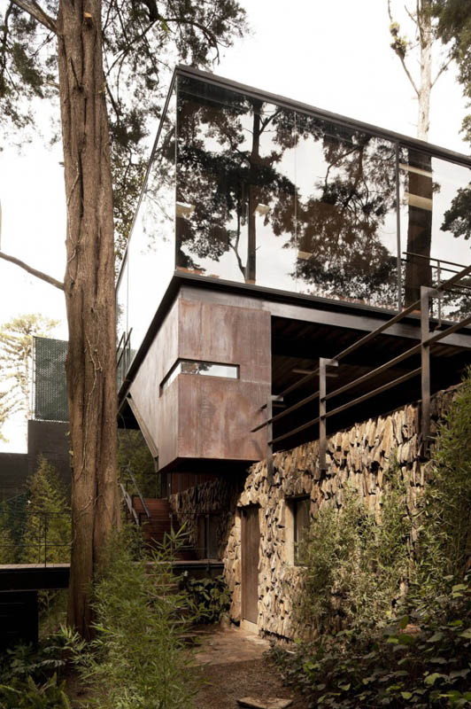 house in forest with trees growing through it 22 An Incredible Home in the Forest With Trees Growing Through It