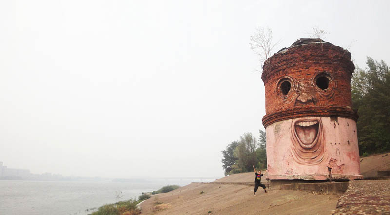 street art nikita nomerz bringing buildings to life 2 15 Street Art Portraits Chiseled Into Walls
