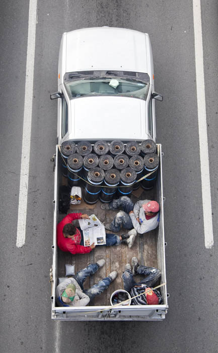aerial birds eye view of people riding car pooling in back of pickup trucks from above alejandro cartagena 1 Riding in the Back of Pickup Trucks   A Birds Eye View