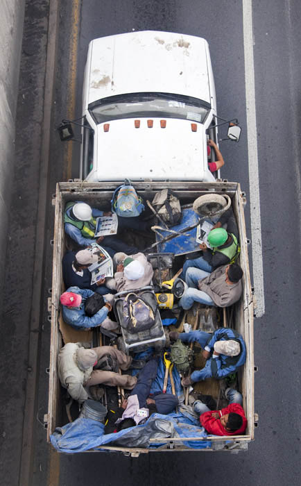 aerial birds eye view of people riding car pooling in back of pickup trucks from above alejandro cartagena 4 Riding in the Back of Pickup Trucks   A Birds Eye View